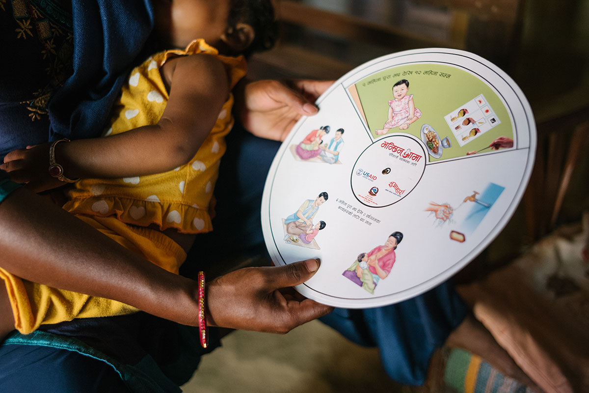 Photo of a woman holding a nutrition instruction wheel
