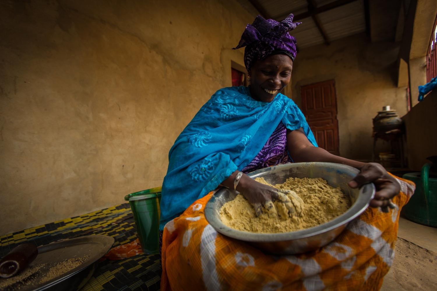 Woman preparing fortified flour for cooking