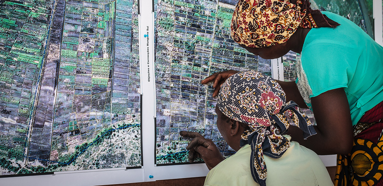 Photo of two women looking at an aerial map